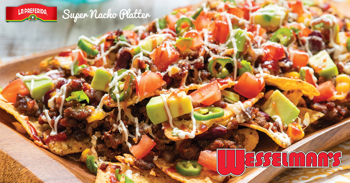 Plate of nachos with toppings.